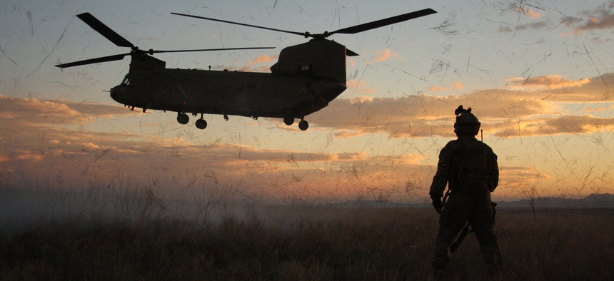 Soldiers from the 4th Aviation Regiment posture for a night air assault raid during a training exercise in Guernsey, Wyoming.