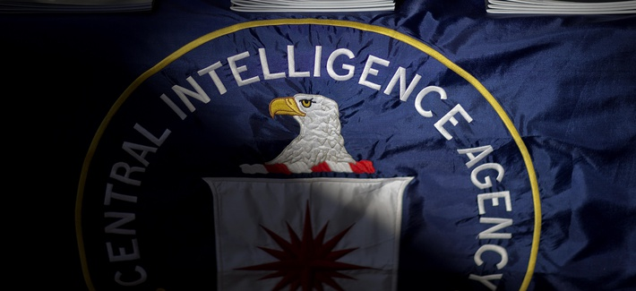 The CIA's logo is seen on a packet containing declassified documents.