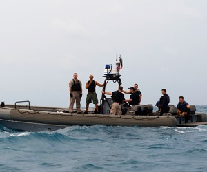 U.S. sailors make preparations to launch a Tow Fish side scan sonar system from the ship's rigid hull inflatable boat in the Java Sea, Jan. 4, 2015.