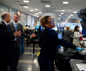 Secretary of Homeland Security Jeh Johnson visits with Transportation Security Administration employees during his visit to Ronald Reagan Washington National Airport on Nov. 24, 2014.