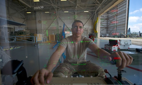 An Airman from Cannon Air Force Base sits at the control module of an MQ-9 Reaper at Hurlburt Field, Fla., April 23, 2014.