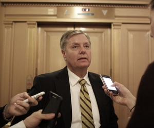Sen. Lindsey Graham speaks to reporters on Capitol Hill after a vote on a $1.1 trillion spending bill to fund the government through the next fiscal year.