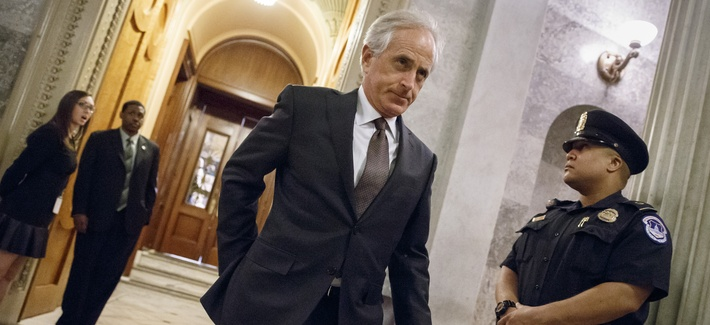 Sen. Bob Corker, R-Tenn., leaves the Senate chamber after a roll call vote at the Capitol in Washington, on November 12, 2014.
