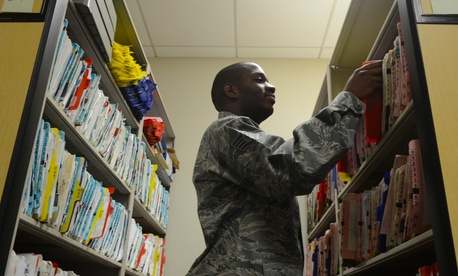 A U.S. Airman files patient records at the USAF Hospital Langley flight medicine clinic at Langley Air Force Base, Va., Dec. 16, 2013.