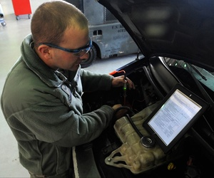 A U.S. Airman tests the power in a motor blower while referencing a technical order on a tablet at Kunsan Air Base, Republic of Korea, Nov. 13, 2012.