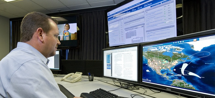 "A cyber security analyst works in a ""watch and warning center"" during a tour of the government's secretive cyber defense lab in Idaho Falls, Idaho."