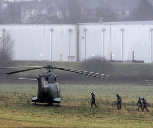 Police and army forces take positions in Dammartin-en-Goele, northeast Paris, as part of an operation to seize two heavily armed suspects, Friday, Jan. 9, 2015.