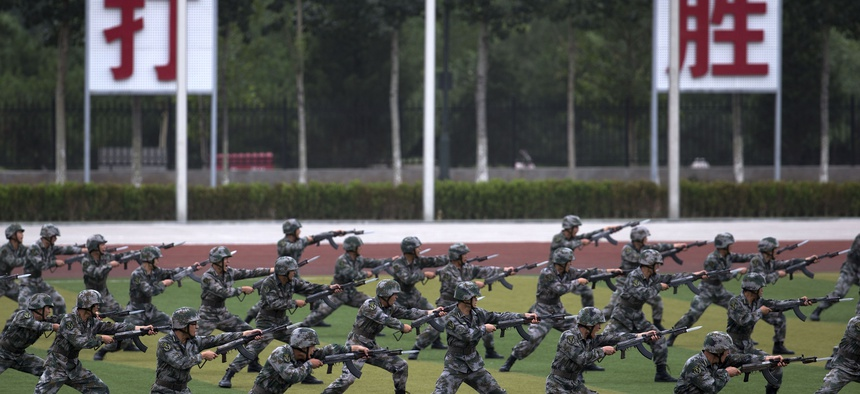Chinese People's Liberation Army cadets take part in bayonet drills at the PLA's Armoured Forces Engineering Base, in Beijing, China, on July 22, 2014.