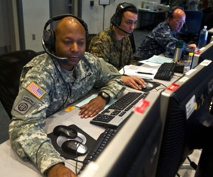 An Army NCO looks through information on a workstation at Combined Air and Space Operations Center-Nellis during Red Flag 14-1.