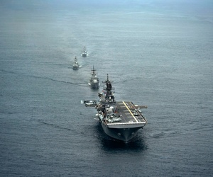 The future USS America and ships from the Peruvian navy sail in formation during a passing exercise in the Pacific Ocean.