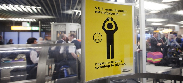 In this Dec. 28, 2009 file photo, an instruction sign is seen inside a body scanner at Schiphol airport, Netherlands.
