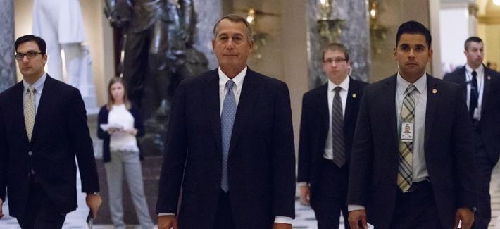 House Speaker John Boehner walks from the House chamber on Capitol Hill, on January 14, 2015.