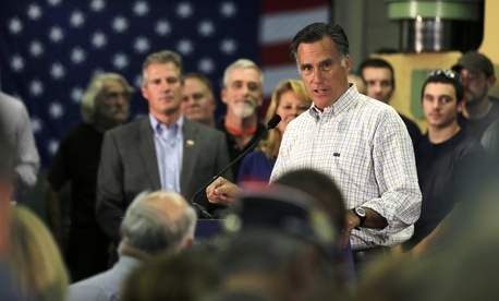 Former Republican Presidential candidate Mitt Romney speaks at a rally for New Hampshire Senate candidate Scott Brown, on October 15, 2014.