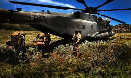 Marines with the 5th Marine Regiment board a CH-53 helicopter for extraction after multiple patrols in the Mountain Warfare Training Center's training area, on June 21, 2014.