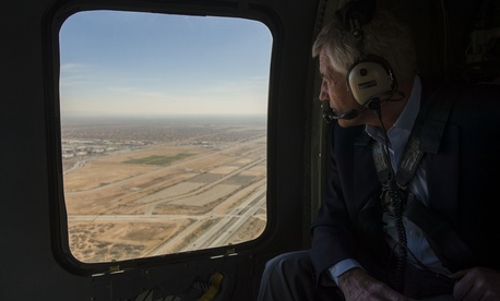 Defense Secretary Chuck Hagel looks out the window of an H-60 Blackhawk helicopter while flying from Fort Bliss, Tx., to Orogrande Range, N.M., on January 15, 2014.