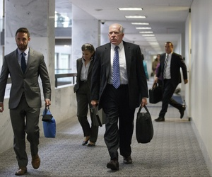 CIA Director John Brennan departs after a closed briefing with the Senate Intelligence Committee, on September 9, 2014.
