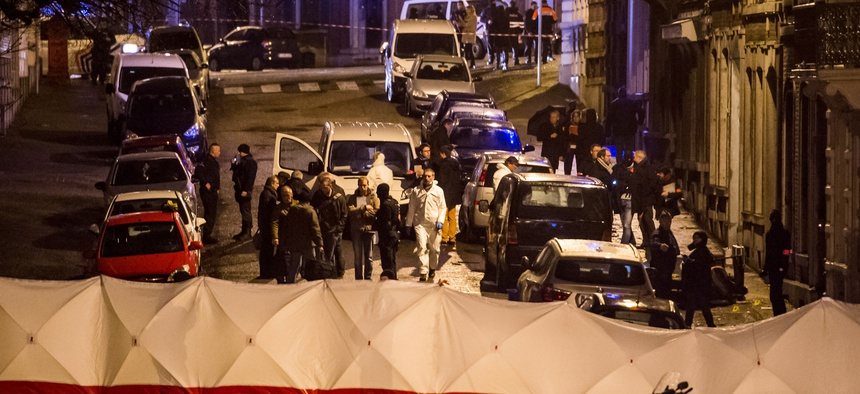 Police investigate a shootout in a street in Verviers, Belgium, on January 15, 2015.