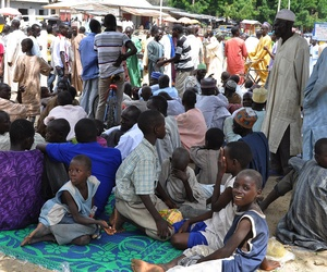 Civilians who fled their homes following an attack by Islamist militants in Bama, take refuge at a school in Maiduguri, Nigeria, on September 3, 2014.