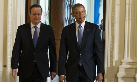 President Barack Obama and British Prime Minister David Cameron arrive for a joint news conference in the East Room of the White House, on Jan. 16, 2015.