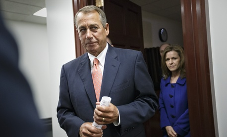 House Speaker John Boehner of Ohio leaves a closed door meeting of the House Republican Conference, on Capitol Hill, on January 13, 2014.