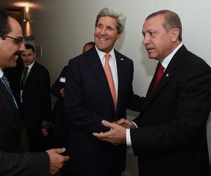 Secretary of State John Kerry and Turkish President Tayyip Erdogan laugh after meeting at the 2014 NATO Summit, on Sept. 4, 2014.