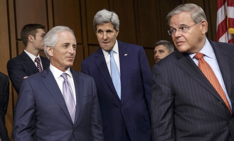 Secretary of State John Kerry, flanked by Sens. Robert Menendez, D-N.J., and Robert Corker, R-Tenn., arrive together to a SFRC hearing, on September 17, 2014.