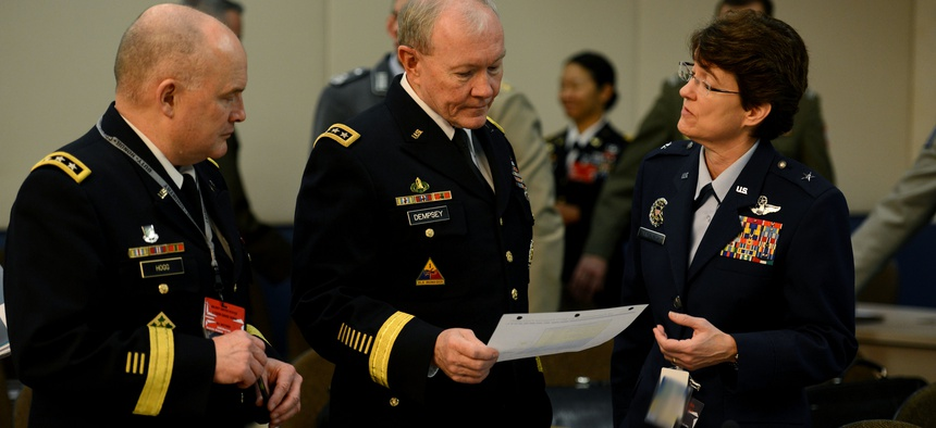 Joint Chiefs Chairman Gen. Martin Dempsey receives a brief from USAF Brig. Gen. Jacqueline Van Ovost, on January 22, 2015.
