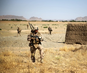 Cpl. Isaac Garcia patrols during a two-day mission in Larr Village, Afghanistan, May 22, 2014.