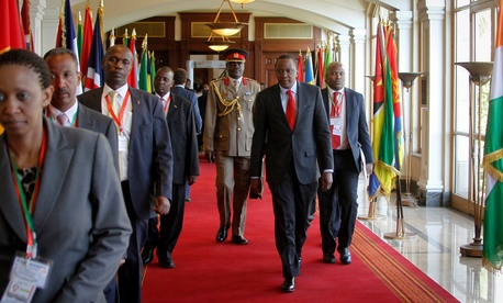 Kenya's President Uhuru Kenyatta, center foreground, arrives for the Intergovernmental Authority on Development (IGAD) summit, held on the eve of the heads of state meeting of the African Union summit, in Addis Ababa, Ethiopia, Jan. 29, 2015.