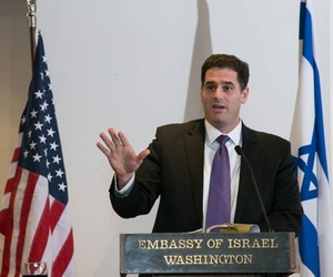 Israel's Ambassador to the U.S. Ron Dermer speaks in front of a crowd at the Israeli Embassy in Washington, D.C.