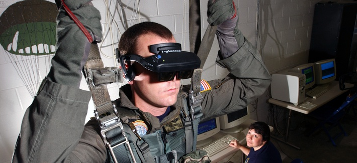 A Marine using a virtual reality parachute trainer.