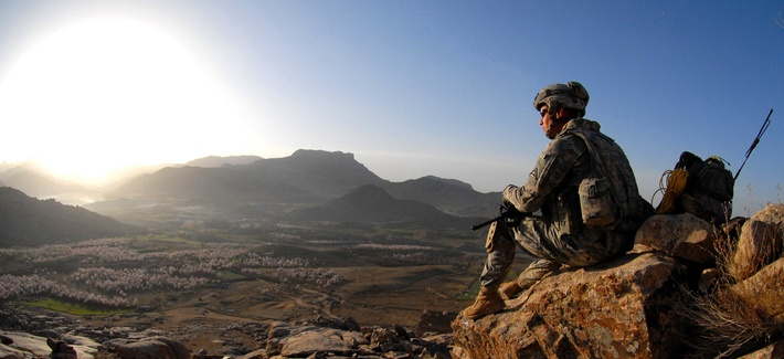 An Army sergeant watches the sunrise after a dismounted patrol mission near Forward Operating Base Baylough, Zabul, Afghanistan, March 19, 2009.