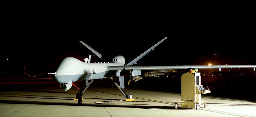 An MQ-9 Reaper sits on the flight line at Hurlburt Field, Fla., April 24, 2014.