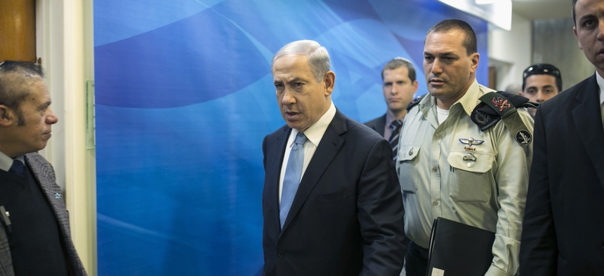 Israeli Prime Minister Benjamin Netanyahu arrives to a weekly cabinet meeting in Jerusalem, on Jan. 25, 2015.