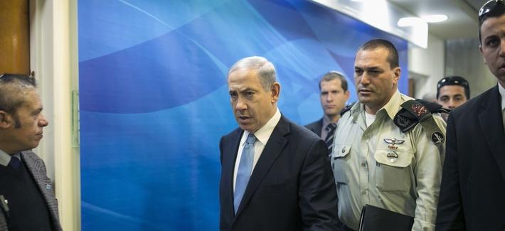 Israeli Prime Minister Benjamin Netanyahu arrives to a weekly cabinet meeting in Jerusalem, on Jan. 25, 2015.