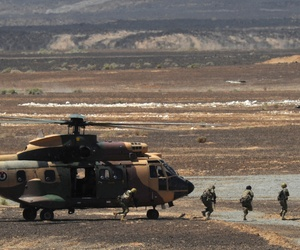 Special operations troops from the Royal Jordanian Armed Forces unload from an AS332 Super Puma during Exercise Eager Tiger, on May 14, 2014.