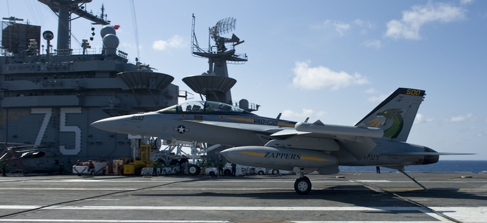 An EA-18G Growler assigned to the Zappers of Airborne Electronic Attack Squadron (VAQ) 130 lands aboard the aircraft carrier USS Harry S. Truman (CVN 75).