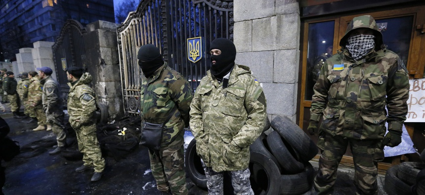 Volunteers of the Aidar battalion picket in front of the Ministry of Defense as they protest against a decision to change the leadership of the battalion in Kiev, Ukraine, Monday, Feb. 2, 2015.
