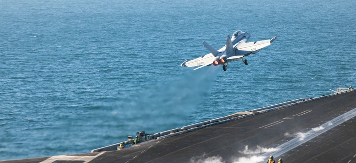 An EA-18G Growler launches from the flight deck of the aircraft carrier USS Carl Vinson as it conducts operations to target ISIS, on January 30, 2015.