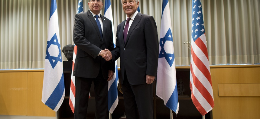 Secretary of Defense Chuck Hagel poses for a photo with Israeli Minister of Defense Moshe Ya'alon in Tel Aviv, Israel, on May 15, 2014.