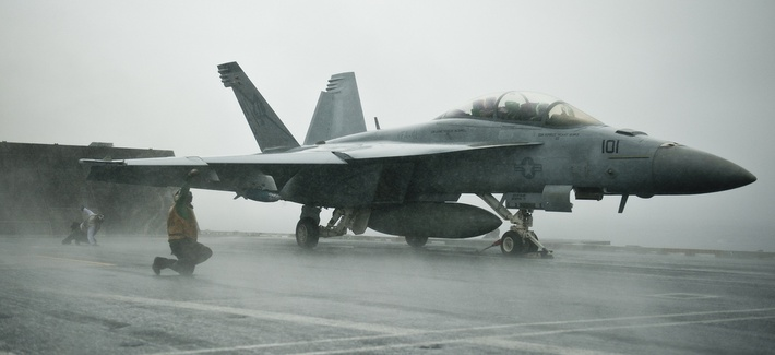 Sailors conduct pre-flight checks on an F/A-18F Super Hornet assigned to Strike Fighter Squadron 41, aboard the USS John C. Stennis, on Sept. 12, 2011.