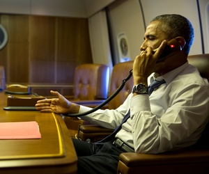 President Barack Obama talks on the phone with French President Francois Hollande from aboard Air Force One, on January 7, 2015.