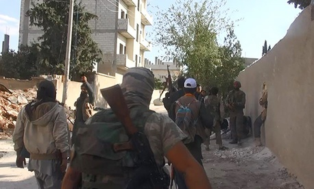 ISIS fighters engage in battle in the border town of Kobani, Syria, on Nov. 4, 2014.