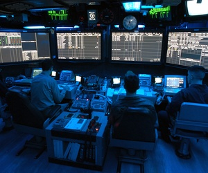 Air Traffic Controllers stand watch aboard the USS George Washington.