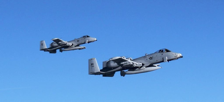 A-10 Thunderbolt II aircraft flown by pilots from the 107th Fighter Squadron head toward Afghanistan after departing Selfridge Air National Guard Base, Mich., Sept. 26, 2011.