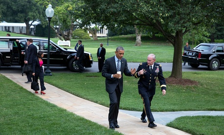 President Barack Obama walks with Gen. Martin Dempsey, Chairman of the Joint Chiefs of Staff, on the South Lawn of the White House, Aug. 6, 2014.