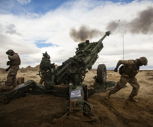 Marines with the 12th Marines fire a M77-A2 Howitzer down range during an Integrated Training Exercise 2-15, at Camp Wilson, Marine Corps, on January 31, 2015.