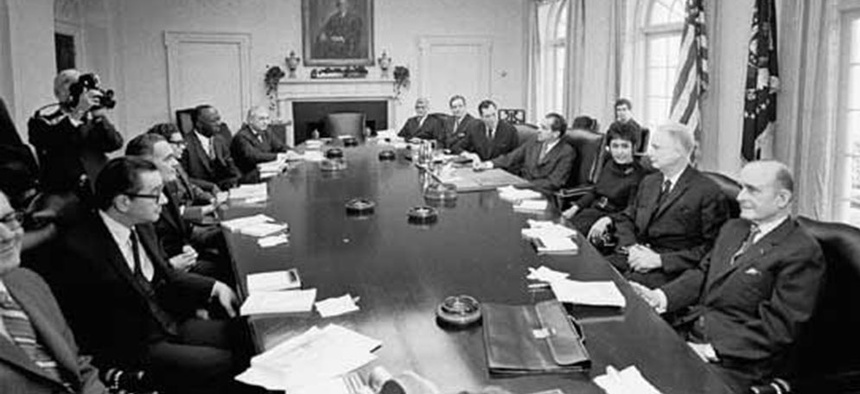 The Gates commission meets at the White House, in 1970.