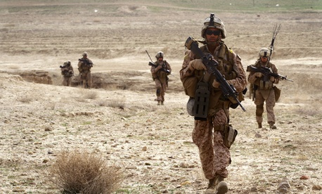 A group of enlisted troops patrol near Observation Post Shrine in the Kajaki District, Afghanistan, on March 16, 2012.