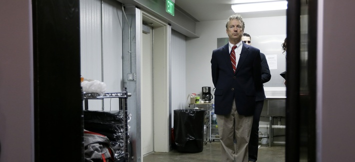 Sen. Rand Paul, R-Ky., waits backstage before speaking at an event in Iowa, on Feb. 6, 2015.